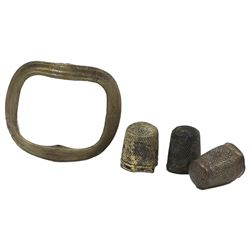 Lot of four small artifacts, ex-Amsterdam (1749): three sewing thimbles and one bronze shoe buckle.