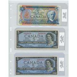x3 five dolllar bills from various years