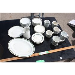 Restaurant Ware: 6 Cups,  24 Various Sized Plates and 1 Cream Pot