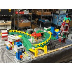 Fisher Price Plastic Railway Pieces and Buildings with Plastic Tote and Lid