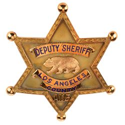 Howard Hughes personal Los Angeles County Deputy Sheriff badge presented by William I. Traeger.