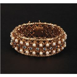 Howard Hughes Gold Ladies Bracelet with (25) Sapphires and Cultured Pearls.