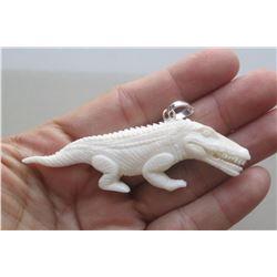 Hand Carved Dinosaurus Pendant
