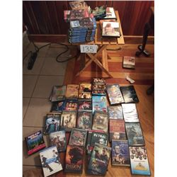 """Folding Stand with approx 50 DVD's table 20""""l x 18""""w x 20""""lt"""