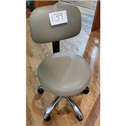 Beige Vinyl Adjustable/swivel office chair