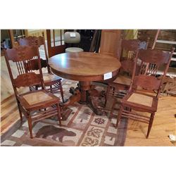 "5 pc OAK ROUND TBL Lion-head/Claw-foot legs - 4 chair spindle back with cane seats - approx 42""d"