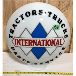 INTERNATIONAL TRACTORS - TRUCKS - PARTS - SERVICE GLASS GLOBE - MODERN