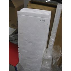 SHEETS OF STYROFOAM AND PLASTIC WRAP