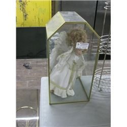 DOLL IN GLASS CASE