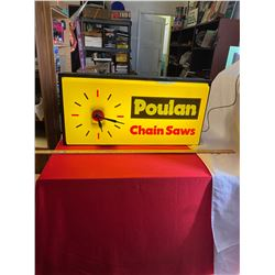 "Poulin Chain Saws Clock. Lights up 25"" x12"" x5 Working"