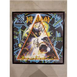 """DEF LEPPARD SIGNED AND FRAMED """"HYSTERIA"""" ALBUM, SIGNED BY JOE ELLIOT, PHIL COLLEN AND RICK ALLEN"""