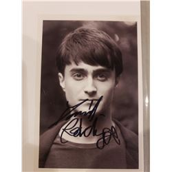 DANIEL RADCLIFFE SIGNED PICTURE WITH CERTIFICATE OF AUTHENTICITY, KNOWN FOR HIS ROLE AS HARRY
