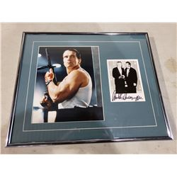 ARNOLD SCHWARZENEGGER SIGNED AND PROFESSIONALLY FRAMED DISPLAY WITH CERTIFICATE OF AUTHENTICITY