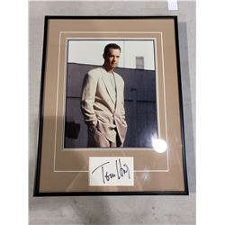 TOM HANKS SIGNED AND PROFESSIONALLY FRAMED DISPLAY WITH CERTIFICATE OF AUTHENTICITY. ONE OF THE