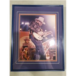 HANK WILLIAMS JR. SIGNED AND PROFESSIONALLY FRAMED PHOTOGRAPH WITH CERTIFICATE OF AUTHENTICITY.