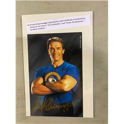 ARNOLD SCHWARZENEGGER SIGNED PICTURE WITH CERTIFICATE OF AUTHENTICITY. KNOWN FOR HIS ROLES IN