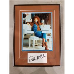 REBA MCENTIRE SIGNED AND PROFESSIONALLY FRAMED DISPLAY WITH CERTIFICATE OF AUTHENTICITY. EXCELLENT