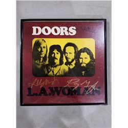 """THE DOORS SIGNED AND FRAMED """"L.A. WOMAN"""" ALBUM, SIGNED BY RAY MANZEREK (1939-2013) AND ROBBIE"""