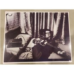 ELVIS COSTELLO SIGNED PICTURE WITH CERTIFICATE OF AUTHENTICITY. INDUCTED INTO THE ROCK AND ROLL