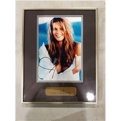 ELLE MACPHERSON SIGNED AND PROFESSIONALLY FRAMED PHOTOGRAPH WITH CERTIFICATE OF AUTHENTICITY. KNOWN