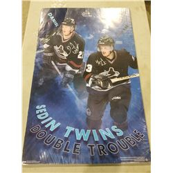 "DANIEL AND HENRIK SEDIN SIGNED VANCOUVER CANUCKS ""DOUBLE TROUBLE"" SIGNED POSTER. GOOD CONDITION"