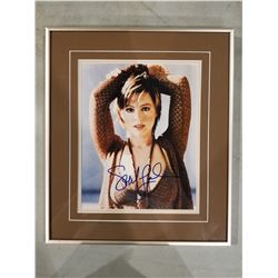 SARAH MCLACHLAN SIGNED AND PROFESSIONALLY FRAMED PHOTOGRAPH WITH CERTIFICATE OF AUTHENTICITY.