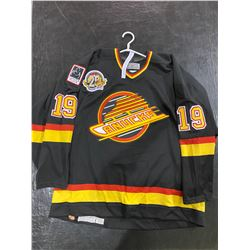 TIM HUNTER SIGNED GAME WORN VANCOUVER CANUCKS JERSEY WITH CERTIFICATE OF AUTHENTICITY. EXCELLENT