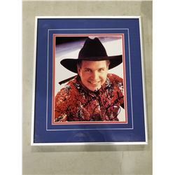 GARTH BROOKS SIGNED AND PROFESSIONALLY FRAMED PHOTOGRAPH WITH CERTIFICATE OF AUTHENTICITY.