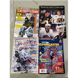 VANCOUVER CANUCKS SIGNED MAGAZINES - VANCOUVER CANUCKS THE SILVER EDITION SIGNED BY PAT QUINN (1943-