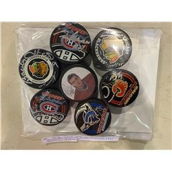 NHL SIGNED PUCKS (7) - INCLUDES PUCKS SIGNED BY BOBBY HULL & GLENN HALL, FRANK MAHOVLICH, PATRICK