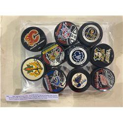 NHL SIGNED PUCKS (10) - INCLUDES PUCKS SIGNED BY BOBBY HULL, DANIEL & HENRIK SEDIN, GUY LAFLEUR &
