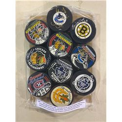 NHL SIGNED PUCKS (10) - INCLUDES PUCKS SIGNED BY BOBBY HULL, HENRIK & DANIEL SEDIN, GLENN HALL, ED