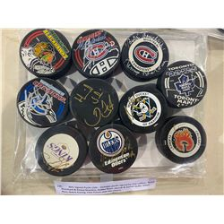 NHL SIGNED PUCKS (10) - INCLUDES PUCKS SIGNED BY GUY LAFLEUR, BUTCH BOUCHARD & KENNY REARDON, BOBBY