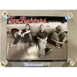 FOO FIGHTERS SIGNED POSTER, SIGNED BY DAVE GROHL AND NATE MENDEL WITH CERTIFICATE OF AUTHENTICITY.