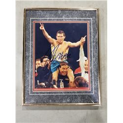 JULIO CESAR CHAVEZ SIGNED AND PROFESSIONALLY FRAMED PHOTOGRAPH WITH CERTIFICATE OF AUTHENTICITY.