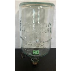 1931 GLASS FUEL BOTTLE