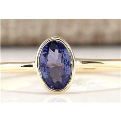 0.60 CTW Natural Tanzanite And Diamond Ring In 14k Yellow Gold