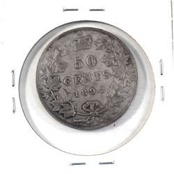 50-cent 1892 Obv.4 in F-VF condition. Coin has a light soft grey tone throughout with some medium to