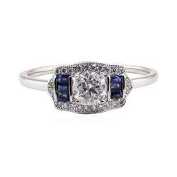 0.64 ctw Diamond and Sapphire Ring - Platinum