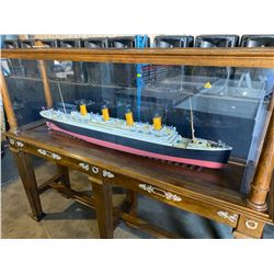 "1:192 SCALE MODEL OF THE TITANIC IN SOLD WOOD WITH GLASS SHOWCASE.  SHIP MEASURES 56"" LONG,"
