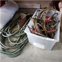 TOTE OF HOSE AND JUMPER CABLES
