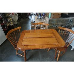 MAPLE DINING TABLE W/2 LEAFS AND 3 CHAIRS