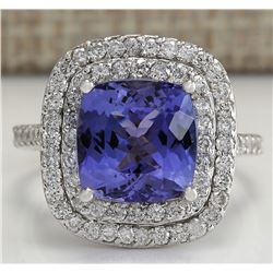 6.09 CTW Natural Blue Tanzanite And Diamond Ring In 18K White Gold
