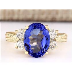 4.10 CTW Natural Tanzanite And Diamond Ring In 18K Yellow Gold