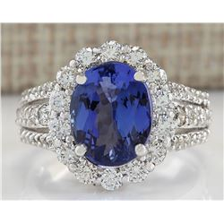 6.72 CTW Natural Tanzanite And Diamond Ring In 18K White Gold