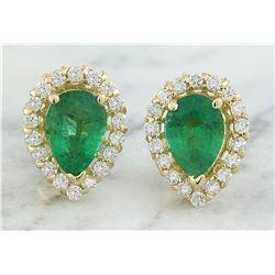 1.45 CTW Emerald 18K yellow Gold Diamond Earrings