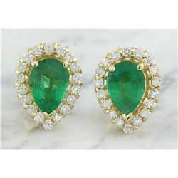 1.45 CTW Emerald 14K yellow Gold Diamond Earrings