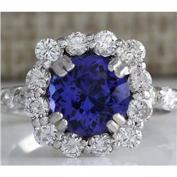 4.12 CTW Natural Blue Tanzanite And Diamond Ring In 14K White Gold