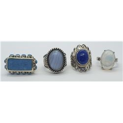 4-STERLING RINGS w/BLUE STONES