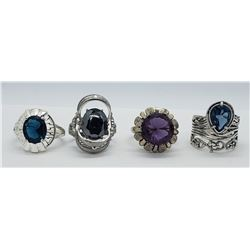 4-STERLING RINGS WITH DEEP BLUE CENTER STONE